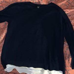 A long sleeve navy blue sweater